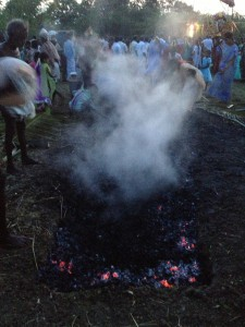 Around 50 villagers walked across the 20 feet long pit filled with hot coal embers